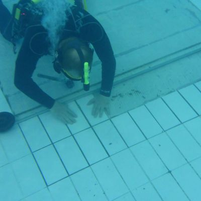 Underwater Tiling and Grouting by Access Underwater